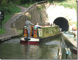 Narowboat Jameson heads into a canal tunnel.